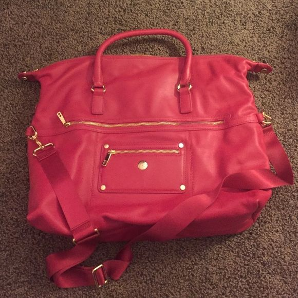 Pink/red knomo London bag Beautiful pink/red leather Knomo bag with purple interior. Gold zippers/accents. Has both handles and strap for wearing as a cross body bag. Medium to large. Contains tracking number which is registered to me, and I could switch over to its new owner. Great overnight bag if you pack light. Only used a few times but turned out to be too cumbersome for my work. Knomo Bags Totes