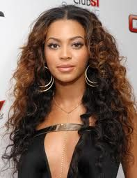 Recreate Beyonce's look with Sundara's 10 ounce layered hair, Virgin Curly, Natural Dark Brown. Custom color top half, ombre technique. Style with a middle part. Full Sew in with natural part.