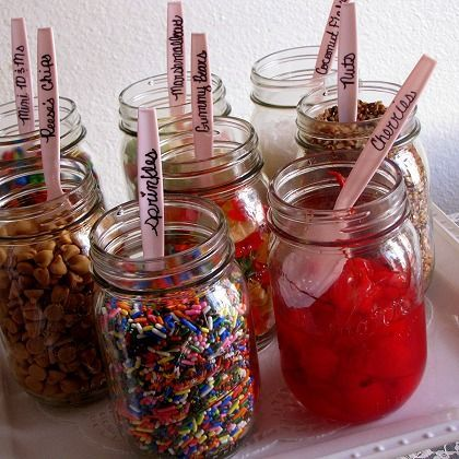 IDEA: Mason jars make creative containers for ice cream toppings! Write the topping on each spoon to help guests choose what they like. See more party ideas at CatchMyParty.com.