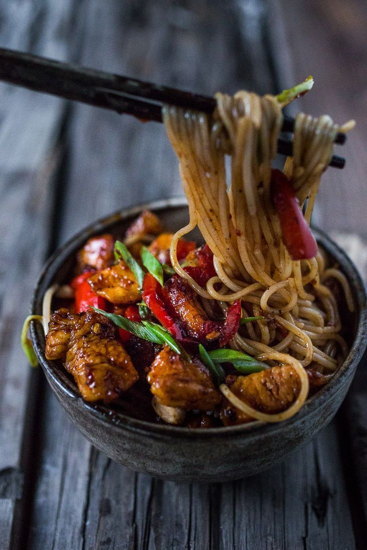 A simple delicious recipe for Kung Pao Noodles that can be made with chicken, tofu. fish or vegetables, served over noodles. | http://www.feastingathome.com
