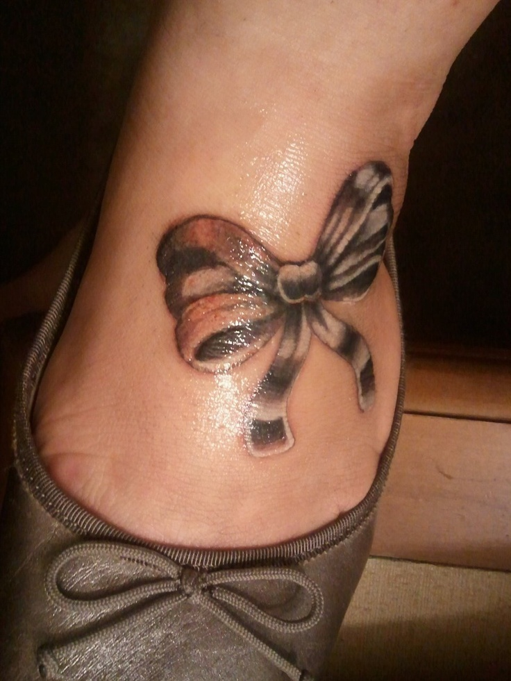Bow tattoo on foot ♥  This hurt so bad!
