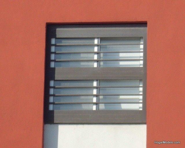 Fotografía de diseño de protecciones de ventanas elaboradas con rejas de herrería horizontal