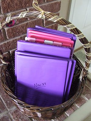 Waltzing Matilda: Advent Basket of Books. Every year wrap up Christmas books in purple and pink paper. Read one for each day of Advent. She has a list of suggested books for each day, as well as book suggestions for the 12 days of Christmas which you can wrap in gold paper.
