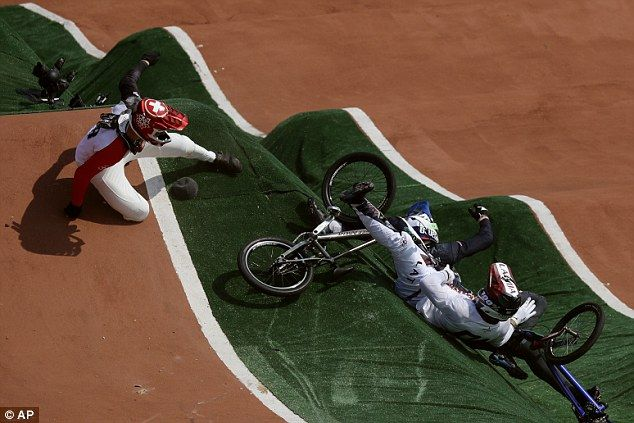David Graf of Switzerland, left, and Maris Strombergs of Latvia, right, fell during the BMX cycling quarterfinals . Stromberg was forced to pull out