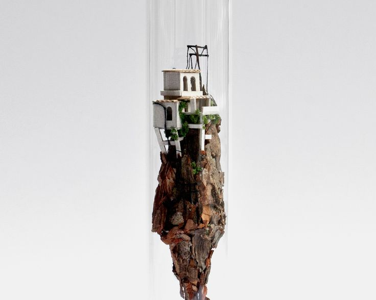 For her series Micro Matter, Amsterdam-based designer and art director Rosa de Jong created towering houses and tall buildings inside the narrow confines of large glass test tubes. Perhaps comparable to a ship in bottle, the little houses and buildings are all handmade using natural objects and so
