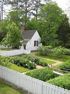 garden.....country appeal!!! miss some color but otherwise i think this is great!! Loooove white fence and entry arbor!!!!  Looove all the garden paths too!!