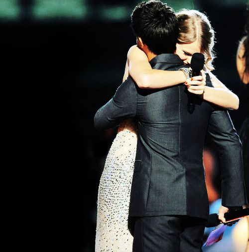 "Taylor and Taylor Lautner after Kanye ruined her VMA. In Back to December ""that september night the first time you ever saw me cry"" this is what that means"