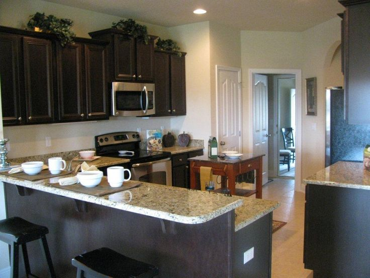 The Bailey floor plan kitchen area makes a great gathering spot ...