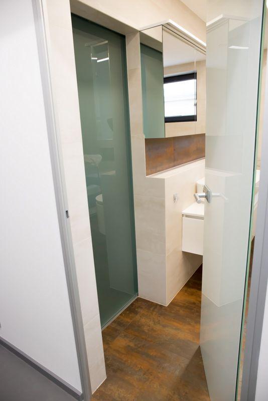 Family bathroom, glass sliding door leading to the walking wardrobe.