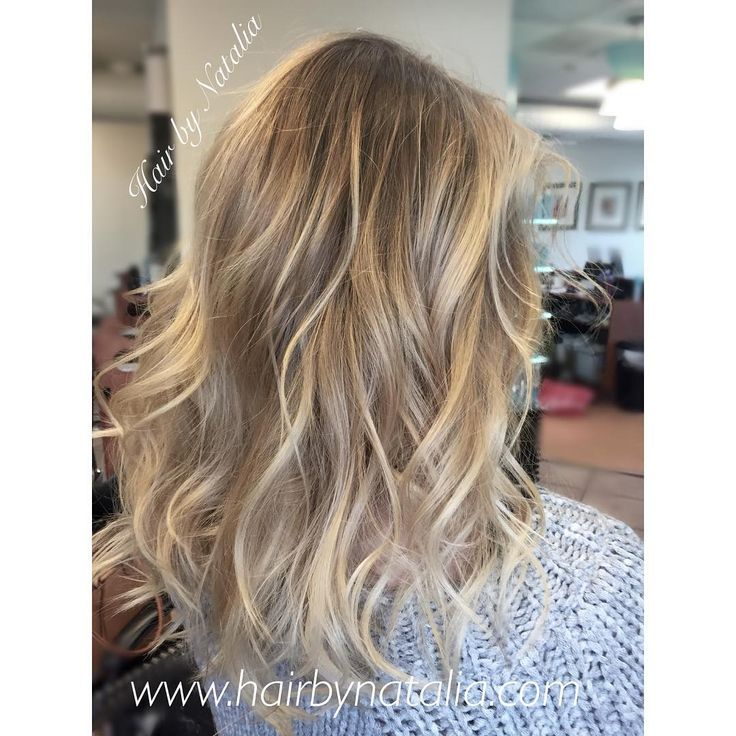 Platinum Blonde Balayage Highlights With Messy Beach Waves