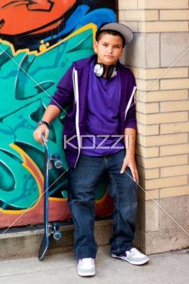 cute teenage boy holding skateboard. - Portrait of a cute teenage boy holding skateboard, Model: Braden Beaudion