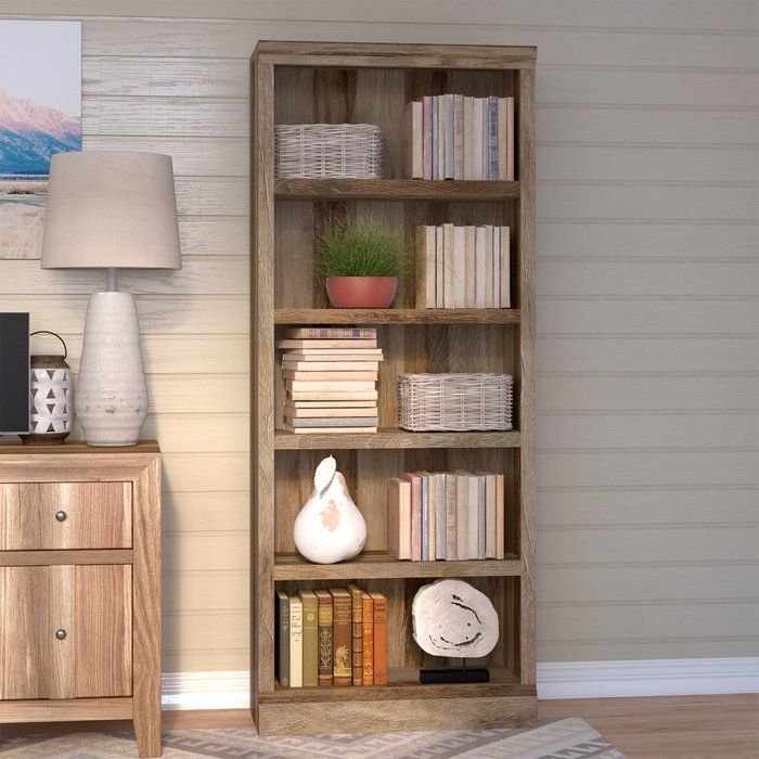 Bookcases aren't just for stowing books, so you can put this piece to work anywhere in your home. Made in the USA, it is constructed of manufactured wood and finished in light craftsman oak. Its five shelves are perfect for much-needed extra storage or display space. Keep it in the den to tuck away a collection of leather-bound tomes and treasured travel souvenirs for a worldly look, or fill it up with framed family photos and antique serveware for the perfect dining room anchor. You migh...