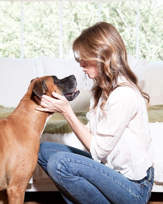 Carole Radziwill, the Emmy-award winning journalist, best-selling author, and star of The Real Housewives of New York, and her Boxer Margaret. July 2012. wmagazine.com