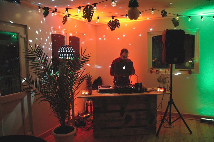 DIY DJ set up made out of pallets for a palm springs inspired party