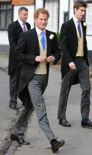 Prince Harry looking handsome in a morning suit of striped trousers, a yellow waistcoat and an eye-catching blue necktie.