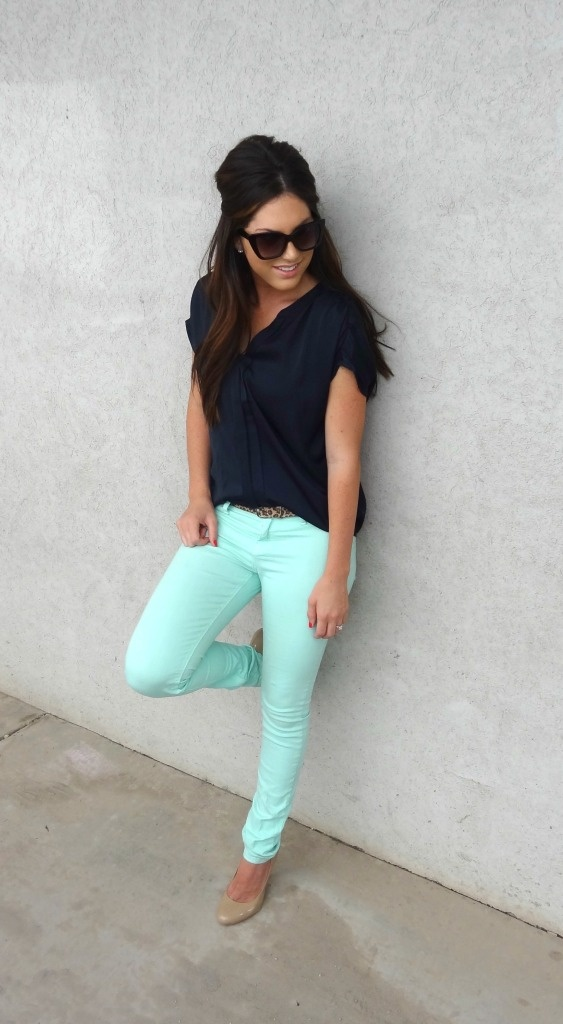 mint jeans and black top.