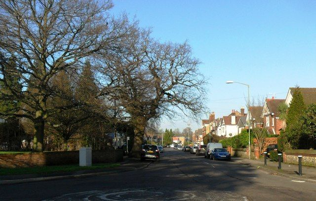 Nutfield Road, Merstham (looking down with All Saints behind left) 2013