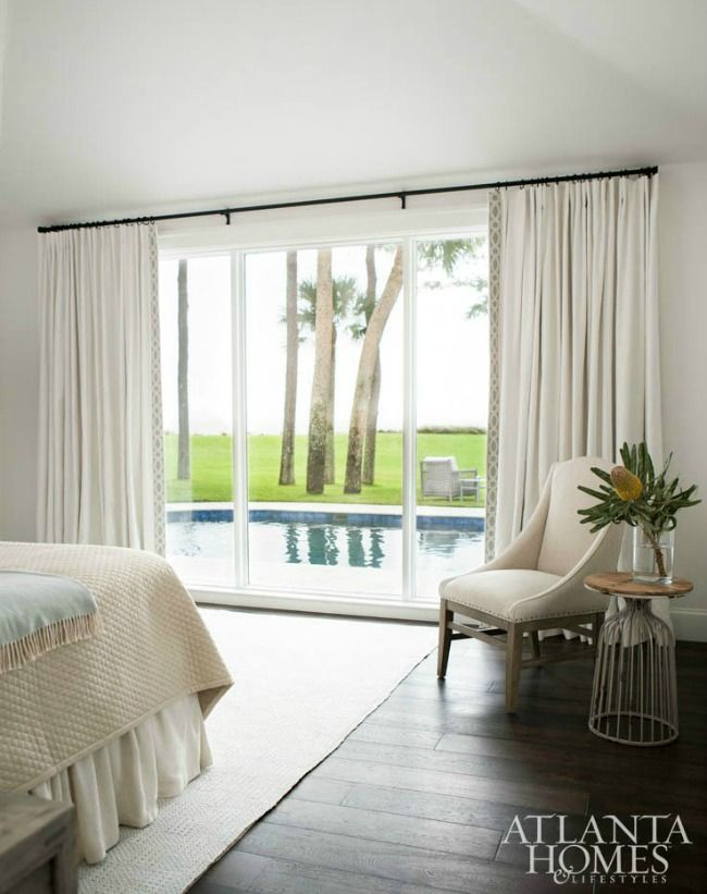 classic neutral bedroom black curtain rod timber
