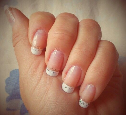 French manicure with the stardust transparent nail lacquer.