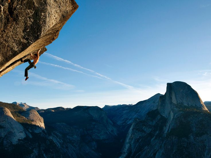 """Climbing without a rope in Yosemite National Park, Dean Potter scales a route called """"Heaven.""""    Photograph by Mike Schaefer, National Geographic"""