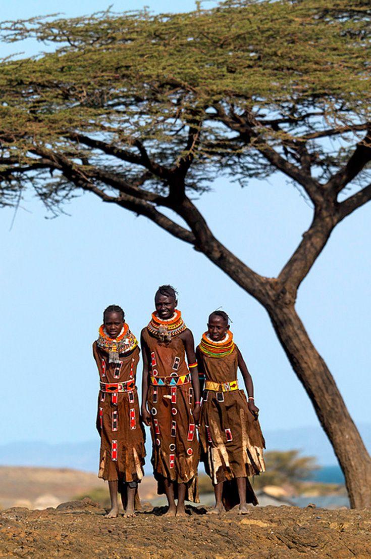 Africa | Turkana girl standing under a tree. Northwest Kenya | ©Eric Lafforgue.
