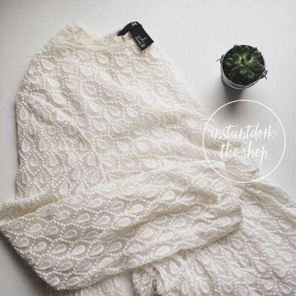 HPH&M Ivory High-Low eyelet top  BEST IN TOPS HP 10/ 09/2015Perfect and ready for your closet. High low, perfect condition and ivory/off white. H&M Tops