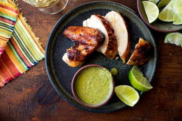 Peruvian chicken is worth learning to make at home because few things beat the crackling skin of a home-roasted chicken. And there's the cilantro sauce on the side. Andrew Scrivani for The New York Times Peruvian Roasted Chicken With Spicy Cilantro Sauce