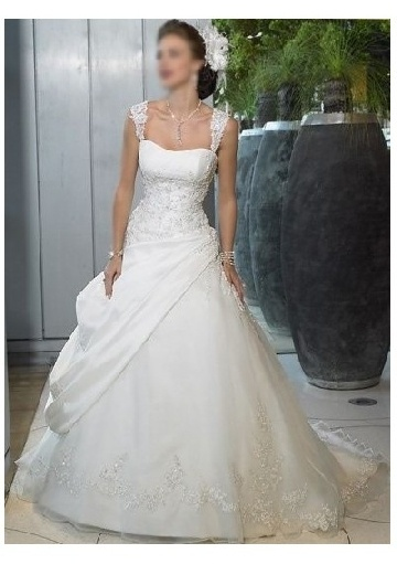 Good way to accentuate bust - bead-detailing all on fitted bodice, but none above empire waist -a line wedding dress with straps