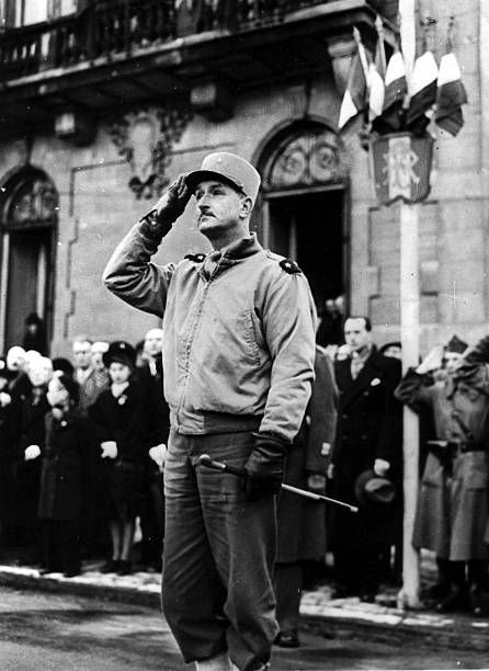 Brigadier General Dim Carpentier, C, G, of the 2nd Moroccan Division, 1st French Army salutes the colors during ceremonies celebrating the liberation of Belfort (France) November 20, 1944. Pin by Paolo Marzioli