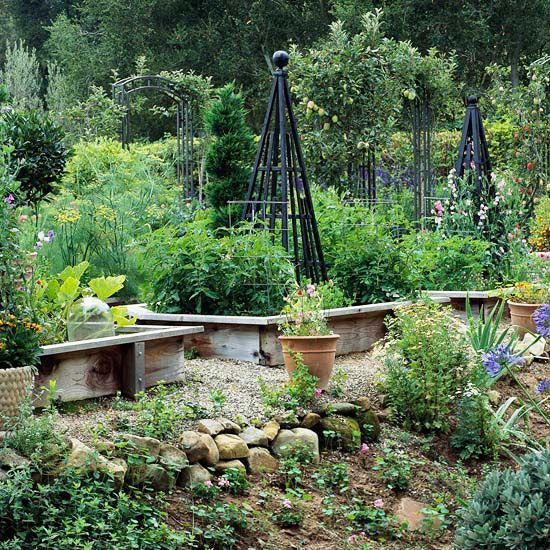 raised beds with ledges to sit on and obelisks