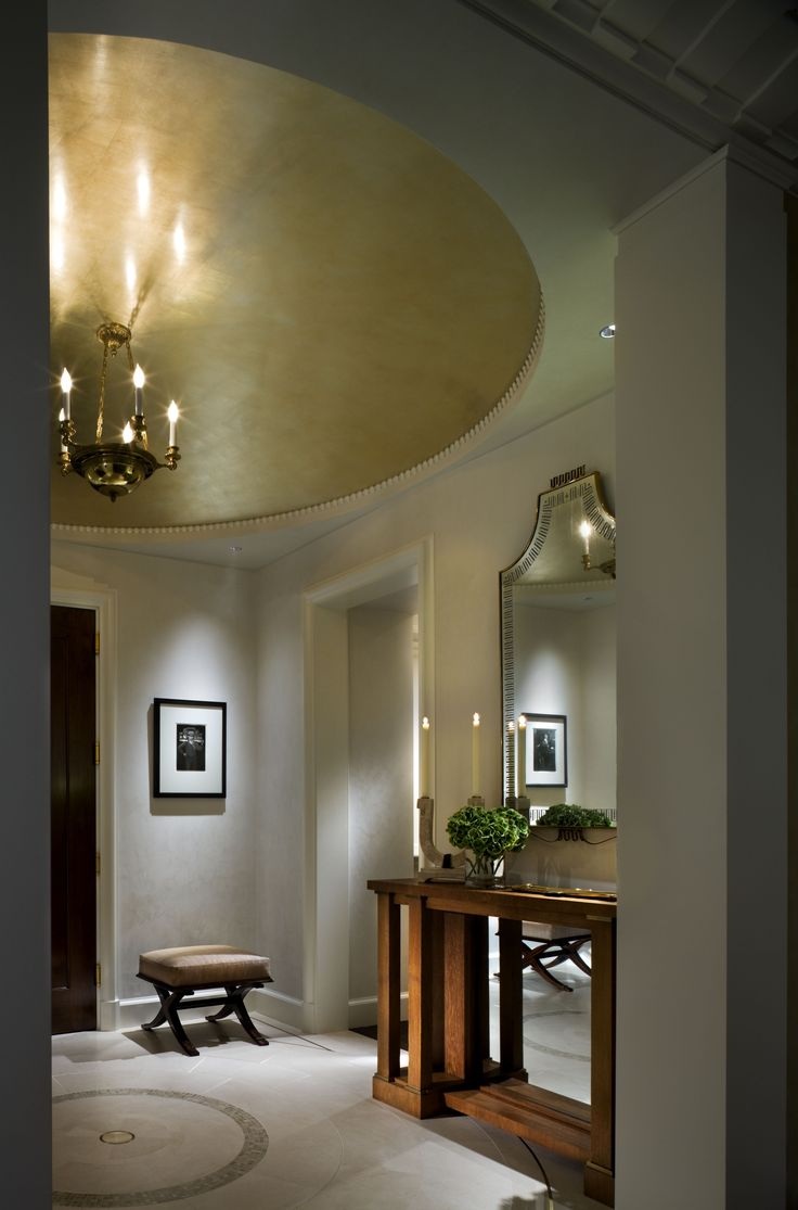 A Gilded Dome Ceiling And Clean White Venetian Plaster