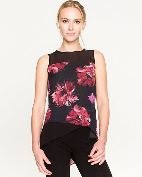 The big red floral on this black top. It is dramatic. It's eye catching. It look great.