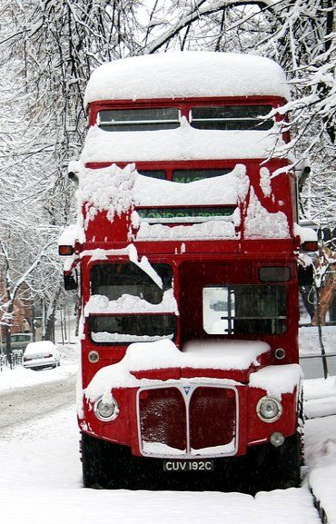 An iconic London double-decker during a rare winter snowstorm