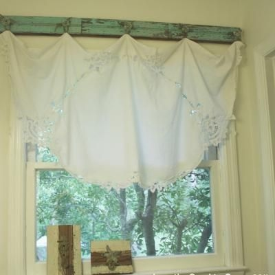 Use Vintage Table Cloth As A Curtain, But I Really Love What Its Hanging  From