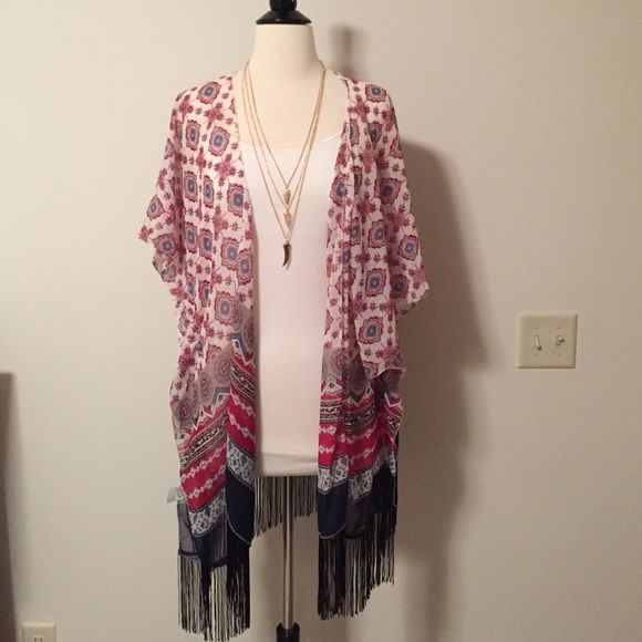 "Sheer printed fringe kimono Beautiful printed sheer kimono. Trendy side slits and fringe around the bottom. 50% polyester, 50% viscose. Approx 32"" long and 38"" wide. Necklace sold separate November Raine Accessories Scarves & Wraps"