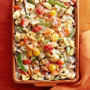 Tortellini and Garden Vegetable Bake Sugar snap peas and cherry tomatoes brighten this saucy chicken casserole recipe.