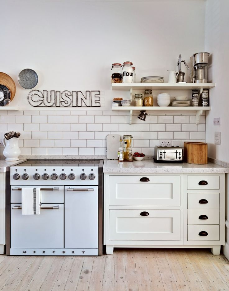White Country Kitchen with Range Cooker and Timber Flooring