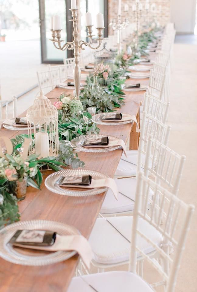 Every aspect of a wedding is incredible. Here we see sophistication meeting a rustic theme for the decor on the wedding tables.
