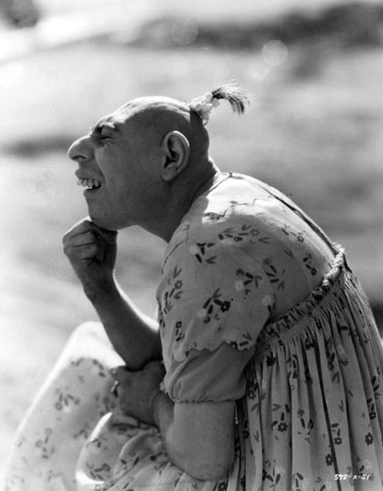 Mr. Schlitzie Surtees - Schlitzie was born with microcephaly, myopia, and severe mental retardation. He was sold as a child to the sideshow, and at the age of 34 was adopted by a chimpanzee trainer. Because of his urinary incontinence, he was made to wear dresses and diapers. On September 24, 1971, at age 70, Schlitzie died from bronchial pneumonia at Fountain View Convalescent Home. Schlitzie was interred in an unmarked grave at 'Queen of Heaven Cemetery' in Rowland Heights.