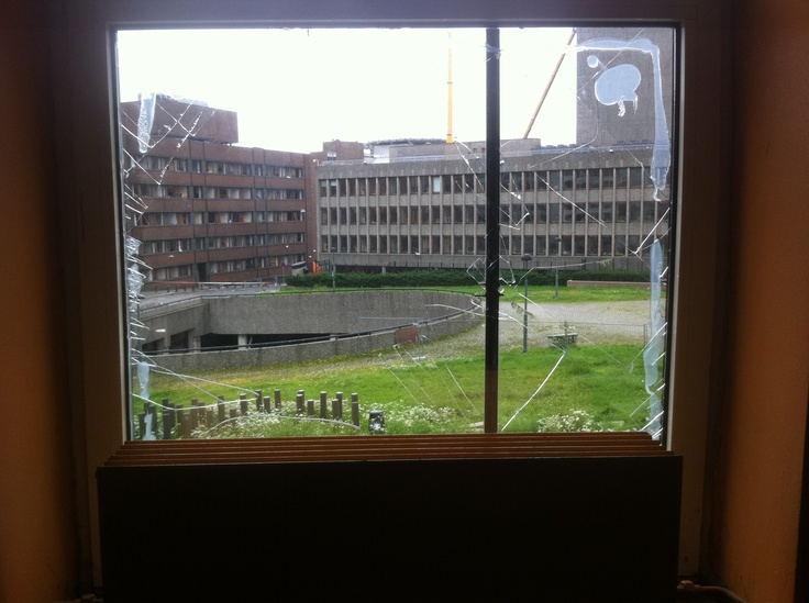 Photographed from inside Deichmanske. View through broken window after the June 2011 bombing.
