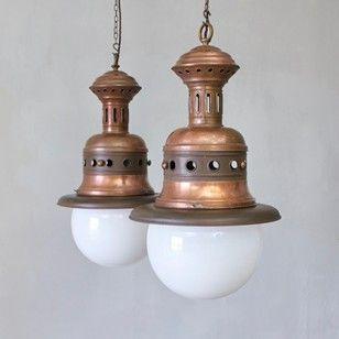 A pair of large copper pendants