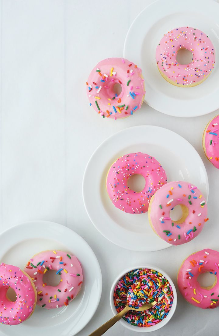 Pretty pink doughnuts with rainbow sprinkles