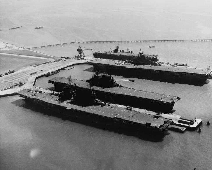 USS Saratoga (CV-3); USS Enterprise (CV-6); USS Hornet (CV-12) and USS San Jacinto (CVL-30) docked at Naval Air Station, Alameda, California. Mid-September, 1945