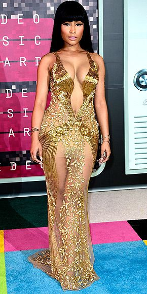 The Best and the Boldest Looks of the Night | NICKI MINAJ  | Looking gorgeous in gold, the VMA nominee glistens in a sheer glittery Labourjoisie gown featuring the most plunging neckline of the night.