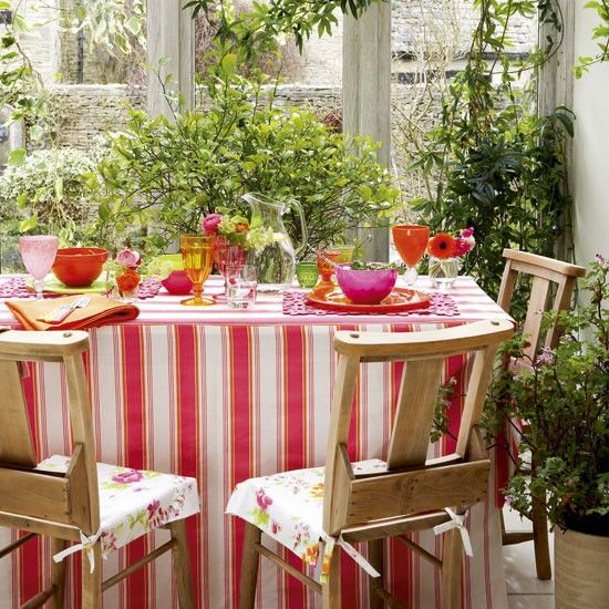 Fill your conservatory with plenty of plants to create a lush, jungle-like feel. Dress a table with colourful linens and antique church chairs for a pretty, country look.