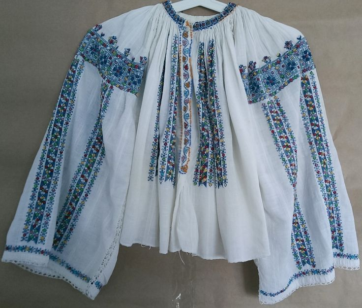 """Very impressive and rare antique romanian traditional top blouse hand embroidered and hand sewn with multicolored cotton thread on homespun traditional fabric. This blouse is very old, is about 80 years old and the embroidery is perfectly preserved (only a 5mm hole on fabric - see picture) .The blouse is heavely decorated with multicolored beads.  Measurements:  Length : 18""""  Sleeve : 22""""  Bust: free""""  We encourage you to ask all of your questions before purchasing any product."""