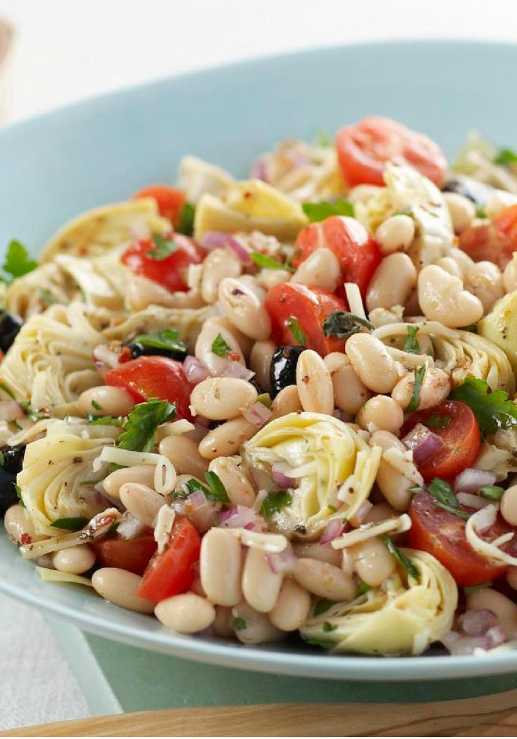 Mediterranean Bean Salad -- Bring this healthy living recipe into your eating plan. Food should look as good as it tastes, and this salad recipe of beans, veggies and cheese delivers in every way.
