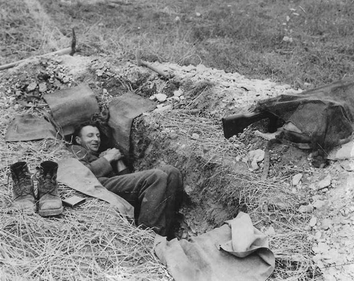"warhistoryonline: ""Canadian Soldier Resting in Foxhole in Normandy France 1944 http://wrhstol.com/2fjjhZJ """