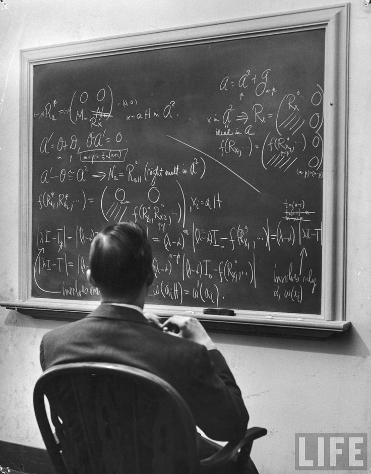 Alfred Eisenstaedt: Richard Schafer, an expert in the field of non-associative algebras, studying complicated formula on blackboard at the I...