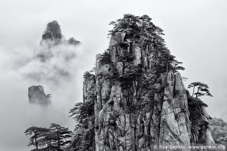 View from Beginning to Believe Lookout, Baiyun Scenic Area, Huangshan (Yellow Mountains), China. Beautiful black and white photo of Huangshan, also known as the Yellow Mountains, in the southern part of the Anhui province in northern China as it's seen from the Beginning-to-believe lookout in Beihai Scenic Area (North Sea). It looks like painting. Huangshan has often been described as the world's most beautiful and enchanting mountain. Over the centuries this mountain with its seventy-two…